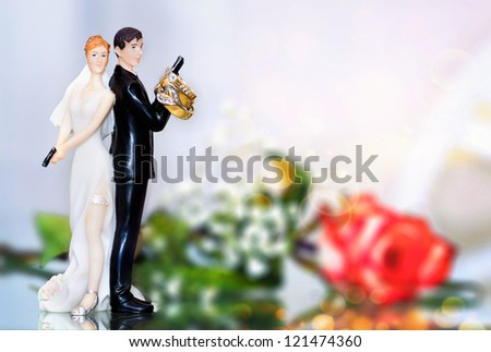 Wedding cake topper in a police style with rings - stock photo