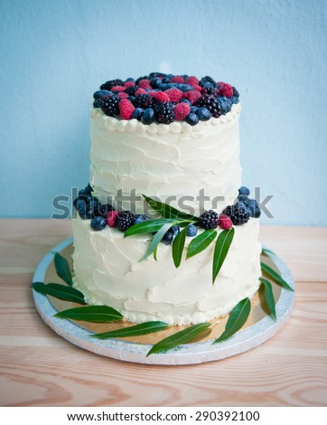 wedding cake with berries - stock photo
