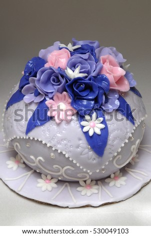 Wedding cake with blue and pink decorations