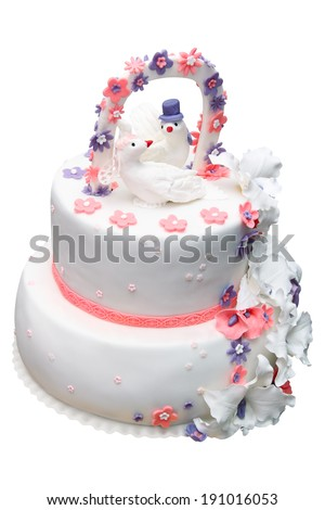 Wedding cake with figures of doves isolated on a white background