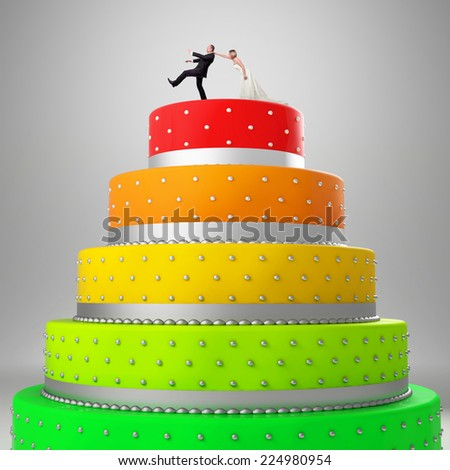 wedding cake with funny caketopper - stock photo