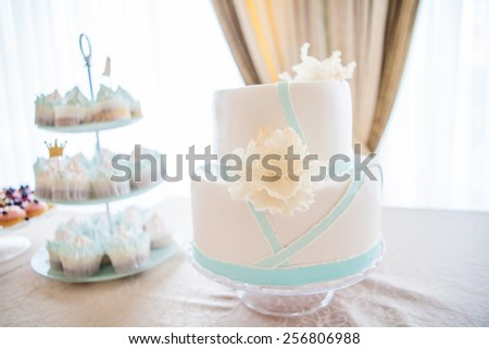 wedding cake with individual decoration at withe table - stock photo