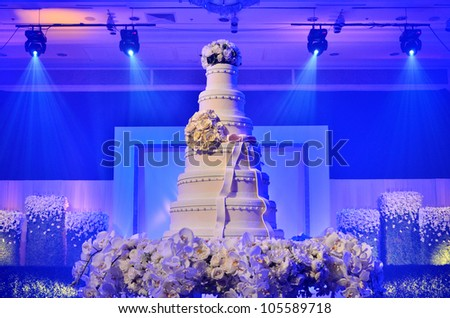 Wedding cake with stage lighting in wedding ceremony - stock photo