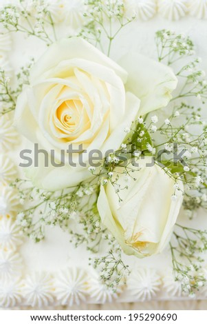 Wedding cake with white roses close up - stock photo