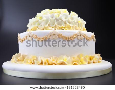 Wedding cake with yellow flowers - stock photo