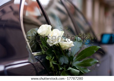 wedding car with beautiful bouquet