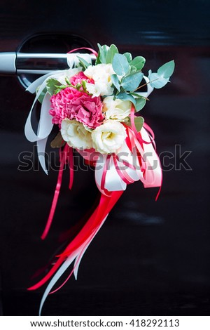 Wedding car with beautiful decorations of pink and white flowers