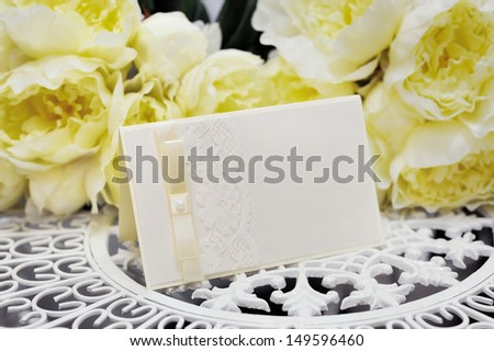 wedding card on a background of yellow flowers - stock photo