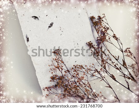 Wedding card with blank handmade paper as a copy space, beautiful herbs over white background - stock photo