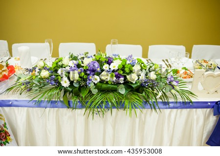 Wedding celebration table with bouquet. Decor trend