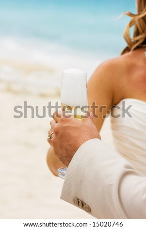 Wedding celebration with champagne on the beach