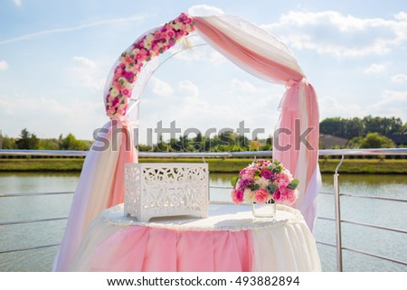 wedding ceremony decorations pink. Flowers decoration wedding ceremony.