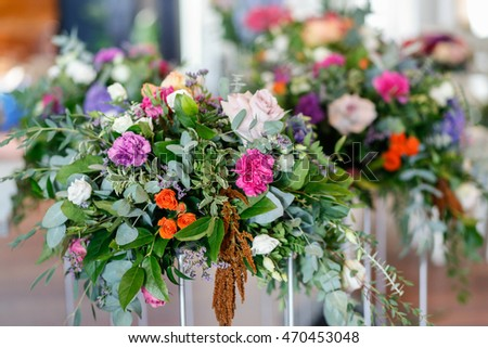 wedding ceremony decorations with colorful flowers, rustic style