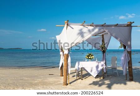 Wedding ceremony dining place on a tropical beach of Koh Samui island, Thailand  - stock photo