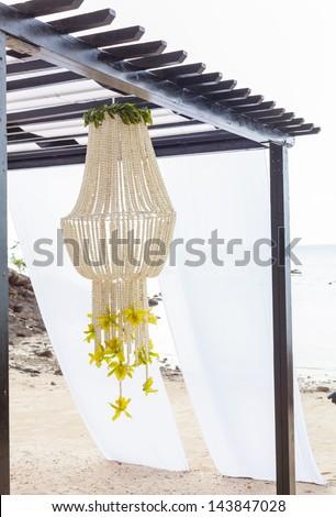 Wedding ceremony on the beach . - stock photo