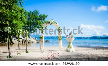 wedding ceremony on the shore of the ocean sea arch on the beach - stock photo