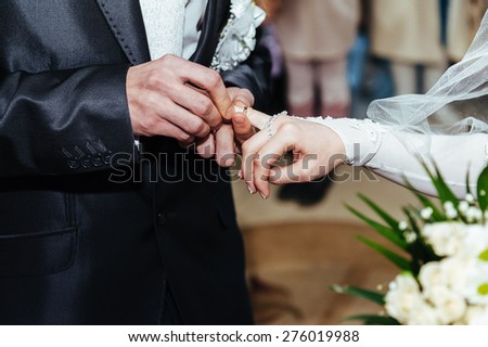 Wedding ceremony. Registry office. A newly-married couple signs the marriage document. Young couple signing wedding documents.