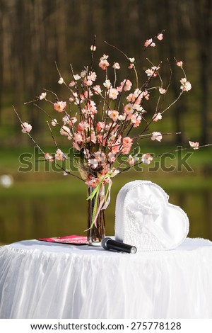 Wedding ceremony -  table with microphone and wedding tree with decoration - stock photo