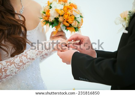 wedding ceremony, the bride and groom exchange rings. Details of the wedding day. - stock photo