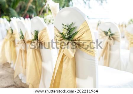 Wedding chairs on the beach at phuket thailand - stock photo