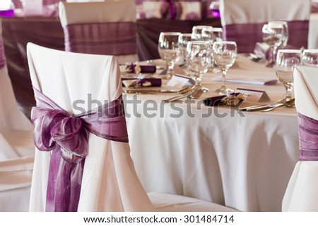 wedding chairs with ribbon - stock photo