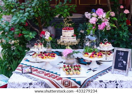 wedding cherry naked cake and another sweet food/ the Chinese means sweet food - stock photo