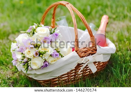 Wedding colorful flowers bouquet with white and purple flowers in creel on green background - stock photo