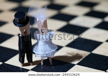 Wedding concept. Clothespins: romantic couple. Bride and groom. Wedding. Valentines day. Man, woman. Gentleman in black hat, woman in white dress. (Soft focus, retro style)