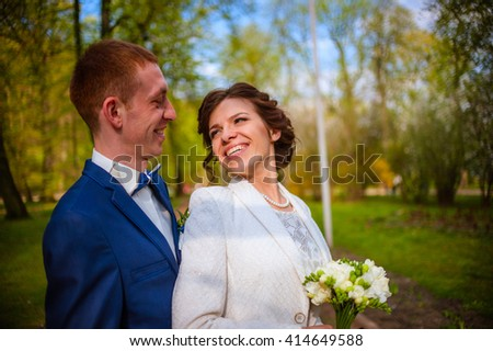 wedding concept. young beautiful wedding couple in the spring park. Smiling and happy - stock photo