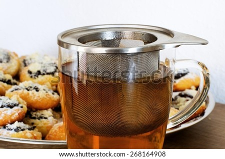 Wedding cookies and cup of tea on the wooden table - stock photo