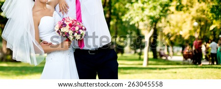 wedding couple and bouquet - stock photo