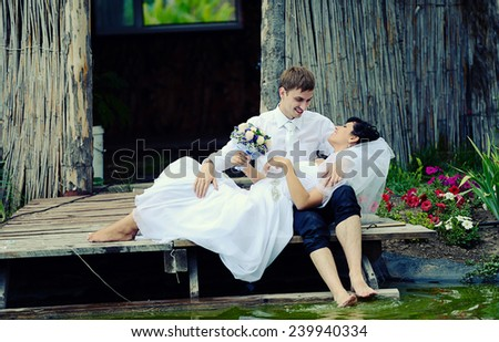 Wedding couple at the lake - stock photo