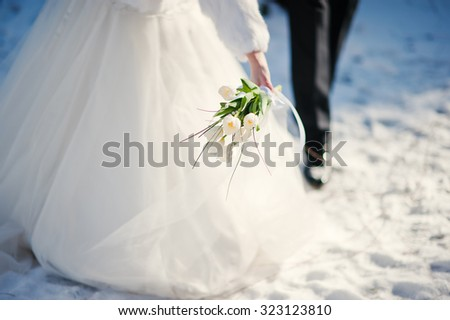 wedding couple at the winter day - stock photo