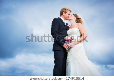 Wedding Couple, Bride and Groom Kissing