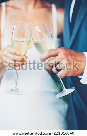 Wedding Couple Champagne Toast - stock photo