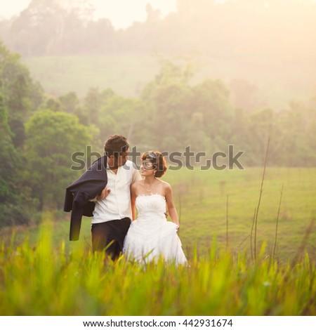 Wedding couple embracing each other moment of joy - stock photo