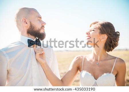 Wedding couple having fun on summer day - stock photo
