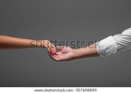 Wedding couple holding hands. bride and groom on grey background - stock photo