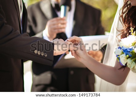 Wedding couple holding hands with rings, bride and groom on wedding ceremony. Wedding couple holding hands. newlywed woman with wedding rings - stock photo