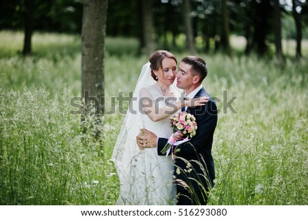 Wedding couple in love at high grass in spring day