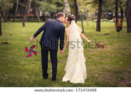wedding: couple in love bride and groom together in bridal summer day enjoy a moment of happiness and love. Beautiful happy newlywed together. handsome man and alluring woman in white dress smiling