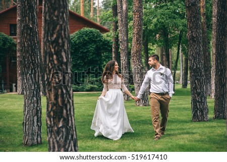 Wedding couple in the park near the house
