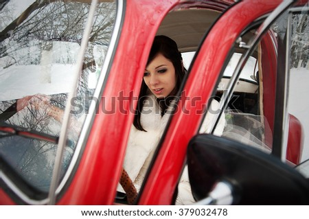 Wedding couple in winter near old vintage car - stock photo