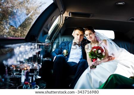 wedding couple indoor the limousine - stock photo