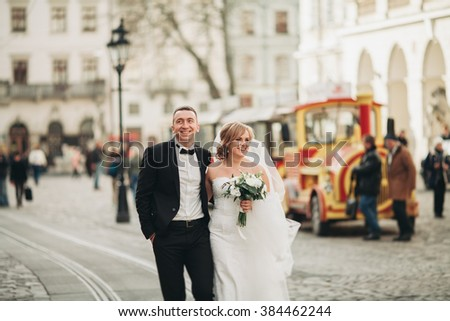 wedding couple is standing and kissing in the streets of old city