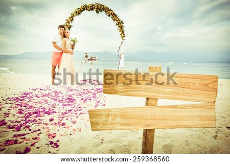 wedding couple just married near the beach at Bali with copy space for text - stock photo