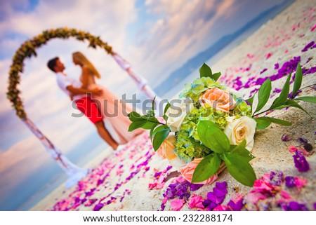 wedding couple just married near the beach at Hawaii - stock photo