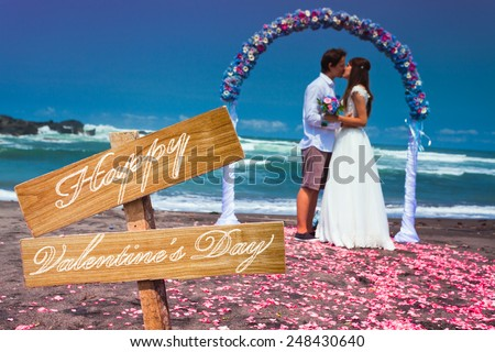 wedding couple just married near the beach at Tenerife with text for valentines day - stock photo
