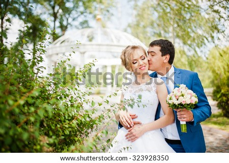 wedding couple near arch of love - stock photo