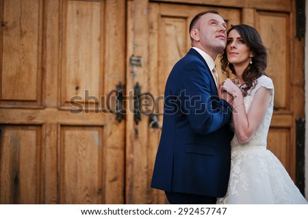 wedding couple on background wooden gates